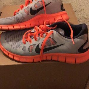 Grey and orange Nike sneakers